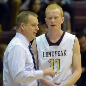 Lone Peak head coach Quincy Lewis and senior TJ Haws discuss strategy during the Knights 90-63 win over Westlake Friday night.