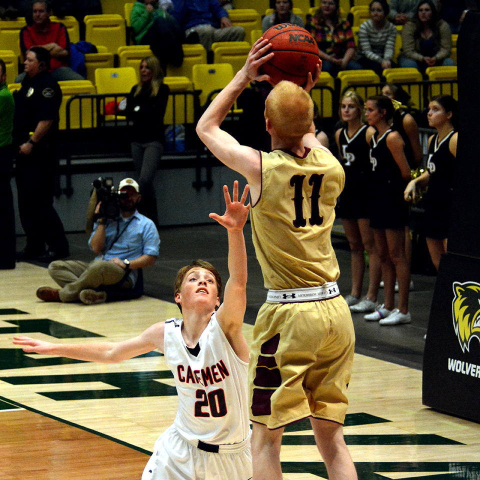TJ Haws hits a mid-range jump shot over Braden Condie during the third quarter of the Knights 68-59 win over the Cavemen.