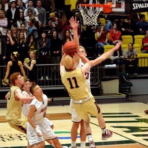 Haws (No. 11) makes a fade away jump shot over the outstretched hand of fellow BYU commit Ryan Andrus.
