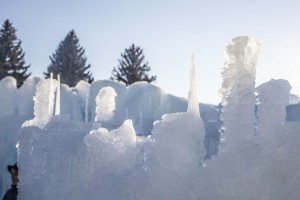 The top of the ice castle wall shows the complex process at work. The ice castle's walls are like rings of a tree, said its creator Brent Christensen, with layers upon layers of ice creating the structure. (Photo by Bethany Davis)