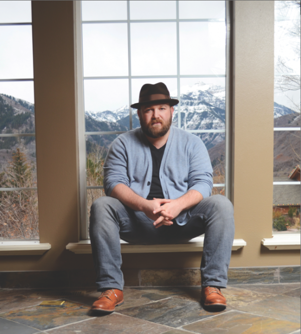 "Ryan Innes' beard screams ""mountain man"" and it's telling the truth. He lives in a cabin in Big Cottonwood Canyon. Here, he is photographed at his uncle's cabin in Provo Canyon. (Photo by Dave Blackhurst)"