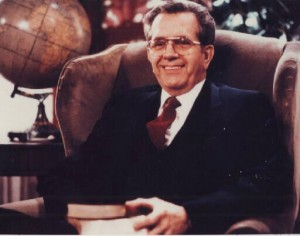 Elder Boyd K. Packer holding the new editions of the scriptures, 1982. (Photo courtesy Mormon Newsroom.)