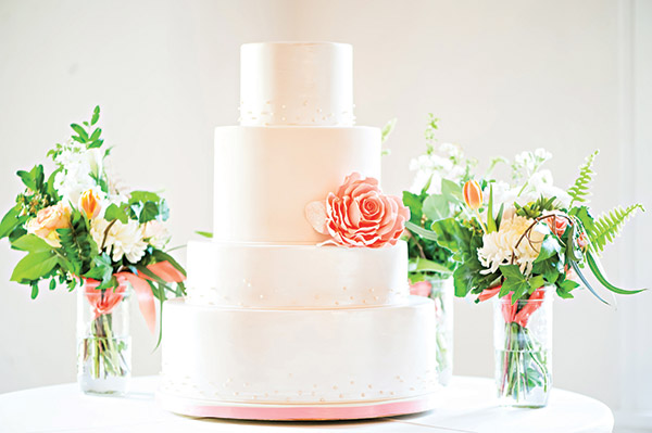 This is what you call gorgeous, classic elegance that will never (we repeat, never!) go out of style. We're also sweet on a cake being surrounded by bouquets. Decadent decor. Brooke Bakken Photography