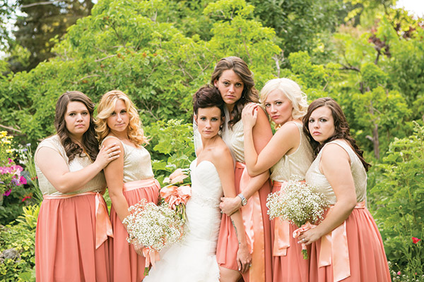 How much do we love this bridal party's hair? Gorgeous curls all around. And when you contrast them with the bride's rockin' up-do? Hair heaven.  Terra Cooper Photography