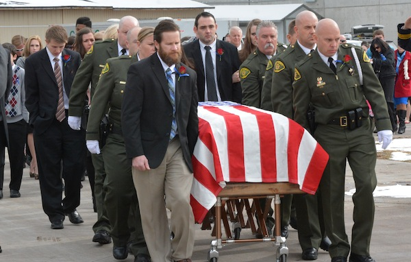 The pallbearers cary Cory Wride's casket out of the UCCU Center after the Wednesday morning funeral service. (Photo by Rebecca Lane)