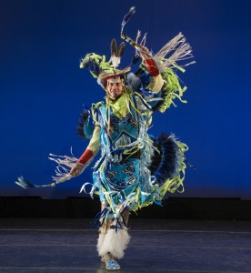 Joel Fonoimoana, of BYU's Living Legends, performs Fancy in traditional Native American dress, a dance depicting the warrior's battlefield feats. (Photo by Mark A. Philbrick)