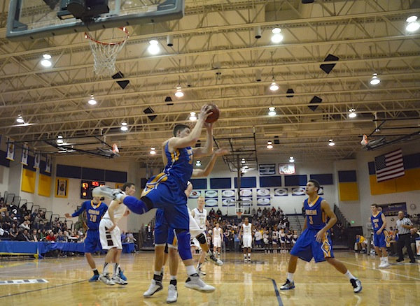 Orem High's Dalton Nixon rebounds the basketball in a game against Lone Peak High School during the 2013-14 season. (Photo by Rebecca Lane)