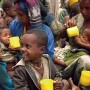 Children in Ethiopia receive a nutritional porridge called Atmit produced by The LDS Church to help relieve starvation. (Photo courtesy Mormon Newsroom.)