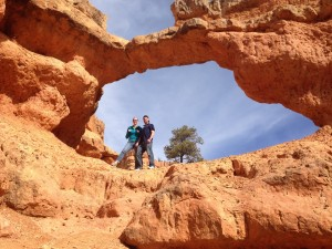 Hikers Christina Davis, left, and Jeff VanDyke strike a pose within one of the 15 arches along the Arches Trail in Dixie National Forest. (Photo by Christa Woodall)