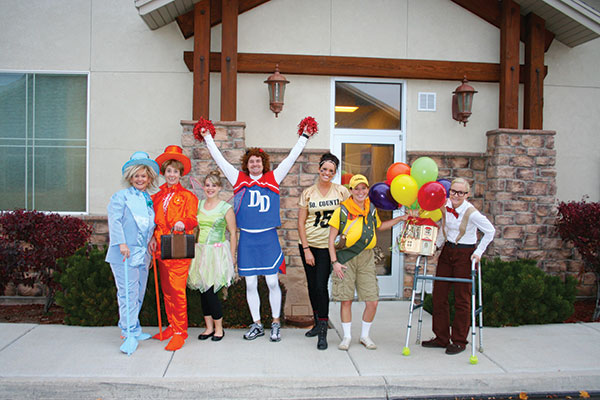 For Halloween in 2013, Dr. Doman (center) dressed up as a cheerleader for himself. Go Dr. Doman! (Photo courtesy of Doman Dental)