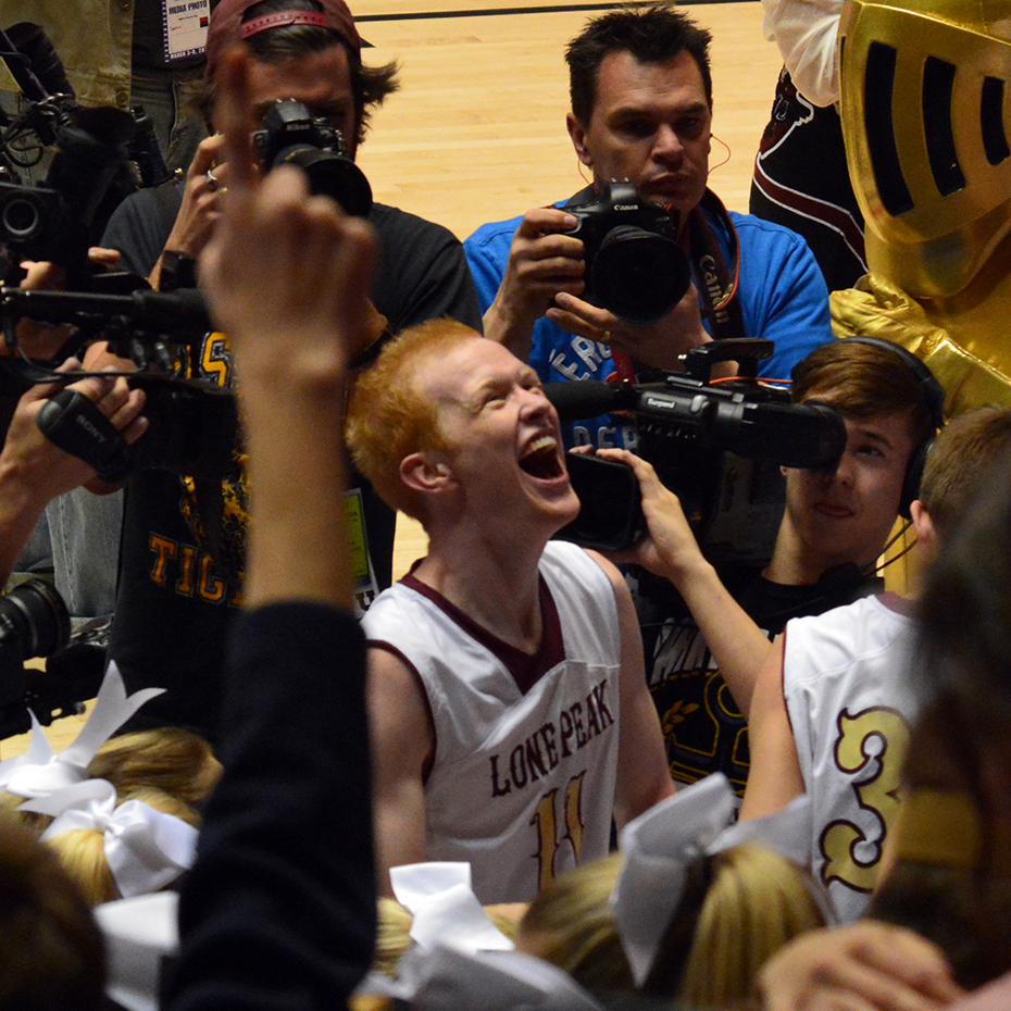 T.J. Haws celebrates Lone Peak's four-peat with the Knight student body.