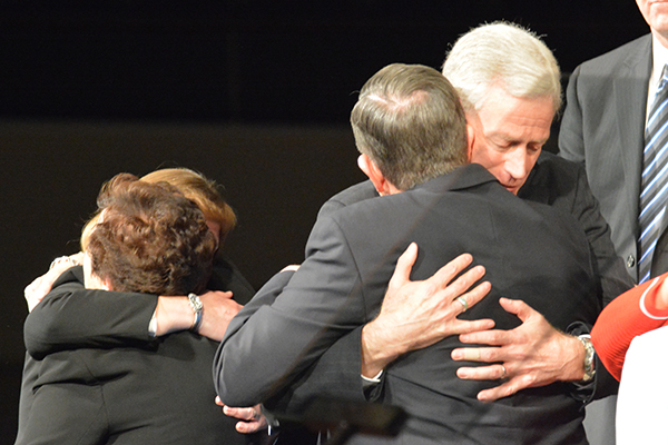 President Cecil O. Samuelson hugs Kevin J Worthen after the announcement while Sharon Samuelson hugs Peggy Worthen in the background. (Photo by Matt Bennett)