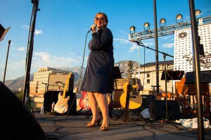 Rooftop Concert Series co-founder and host C. Jane Kendrick works the crowd at the Tom Petty Tribute Concert in July 2012. (Photo courtesy of Justin Hackworth)