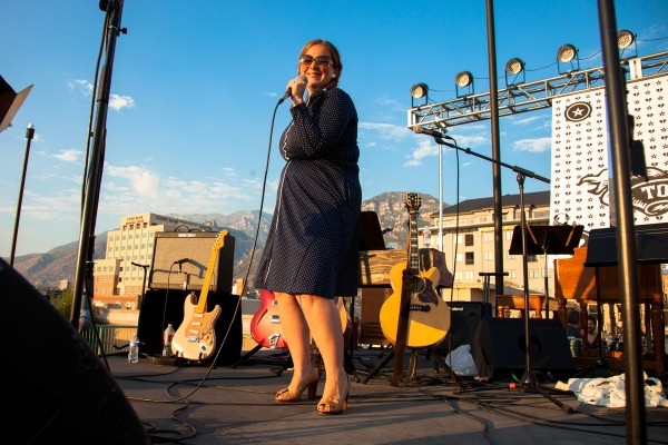 Rooftop Concert Series founder and host C. Jane Kendrick works the crowd at the Tom Petty Tribute Concert in July 2012. (Photo courtesy of Justin Hackworth)