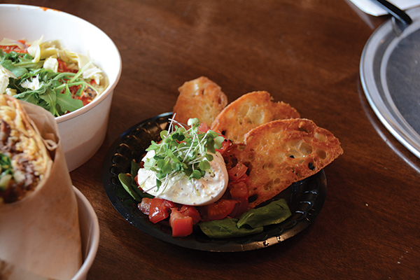 Burrata with grilled bread is a must-order at the counter-service Italian restaurant started by the original Cafe Rio creators.