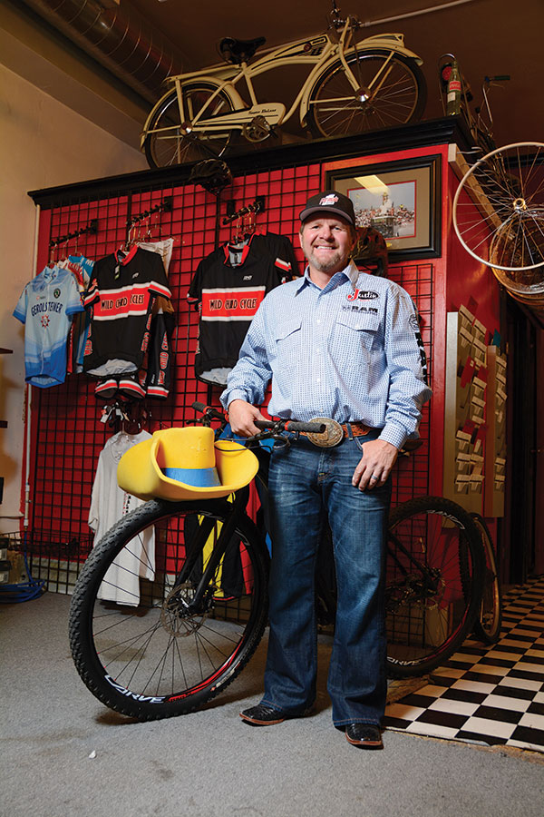 When Troy Lerwill isn't performing extreme rodeo stunts, he enjoys domesticated hobbies like mountain biking. He's owned Wild Child Cycles in Payson for 20 years. (Photo by Dave Blackhurst)