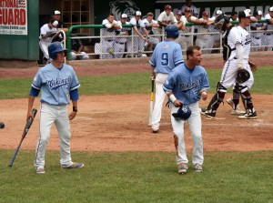 PG's Brayden Cox (20) and Chase Merrell (7) celebrate a big state tournament moment. (Photo by Kurt Johnson)