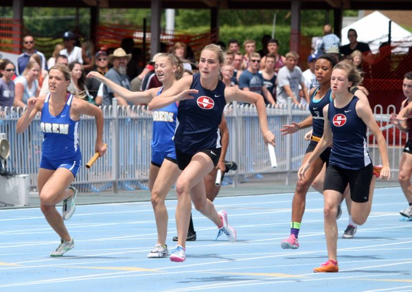 Mckayla Montgomery of Springville takes the baton for the anchor leg in the 4x100 relay. (Photo by Kurt Johnson)
