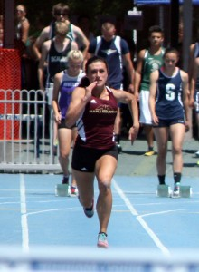 Megan Elmont of Maple Mountain running the 100. She won the state long jump title. (Photo by Kurt Johnson)