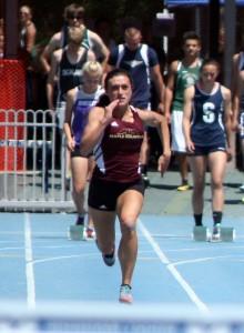 Megan Elmont of Maple Mountain running the 100. She won the state long jump title. (Photo by Kurt Johnson)