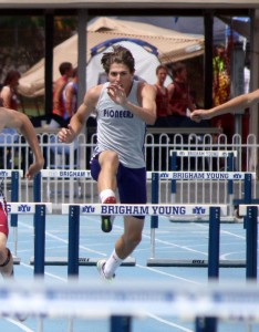 Lehi's Trevor Bursach competes in the 300-meter hurdles after winning state titles in the long jump and high jump. (Photo by Kurt Johnson)
