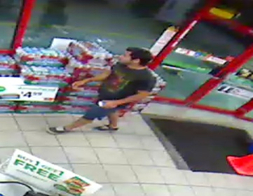 Provo police are searching for a man seen in surveillance footage from the 7-11 at Center Street and Geneva Road in Provo. He bought gas an hour before a suspicious fire at 1585 W. Center St. on Tuesday. (Photo courtesy Provo police)