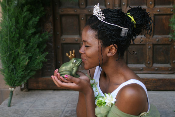 The princess kiss her frog in this photo courtesy the Princess Festival.