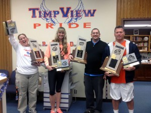 Timpview coaches Michelle Landers (girls tennis), Kristen Bailey (volleyball), Jeff Ward (boys golf) & Cary Whittingham (football) with their state title hardware. (Photo courtesy Timpview High School)
