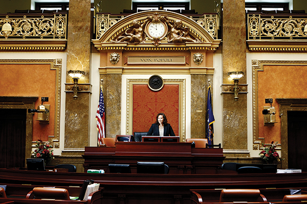 From Becky Lockhart's view as Speaker of the House of Representatives, she can glance up and see a painting of the first woman to vote in Utah. As she gave Utah Valley Magazine a tour of her office and the Capitol, she pointed out the symbolism in the painting, including both open and closed windows. Becky opened a window for Utah women by being the first woman in her leadership role. And now she has chosen to shut this window when her term ends on Dec. 31, 2014.  (Photo by Kenneth Linge)