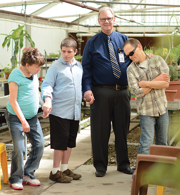 "Guy Thompson is the superintendent at the Developmental Center in American Fork. But his favorite title is ""friend"" to residents such as Ann, Troy and Nathan. Activities for the intellectually challenged adults include growing plants in and around an on-site greenhouse."