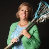 "Renee Tribe grew up as a tomboy in a house full of girls. She liked to skateboard, and most of her friends were boys. It wasn't until eighth grade that she thought, ""I should probably wear a dress — I don't look so bad in it."" Now,  Renee is the co-founder of the GULL lacrosse league and the mother of four boys and one girl. (Photo by Dave Blackhurst)"