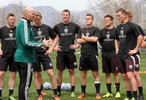 Coach Greg Maas gives instructions to some of his UVU players during a training session. (Photo by Kellen Hiser, UVU Athletics Department)