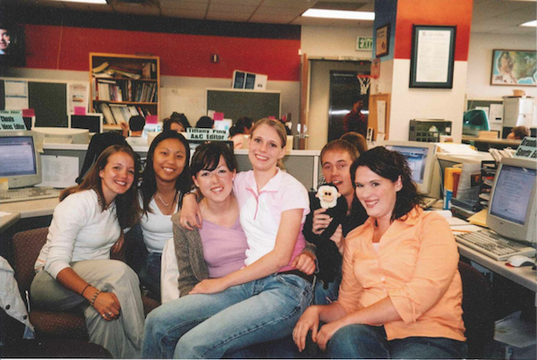 Christa Woodall (far left) sits with the staff at the Daily Universe.