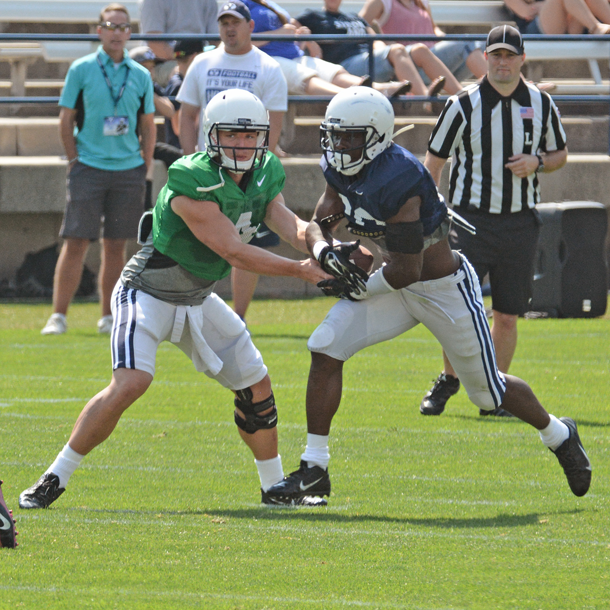 Adam Hine takes a handoff from junior quarterback Taysom Hill.