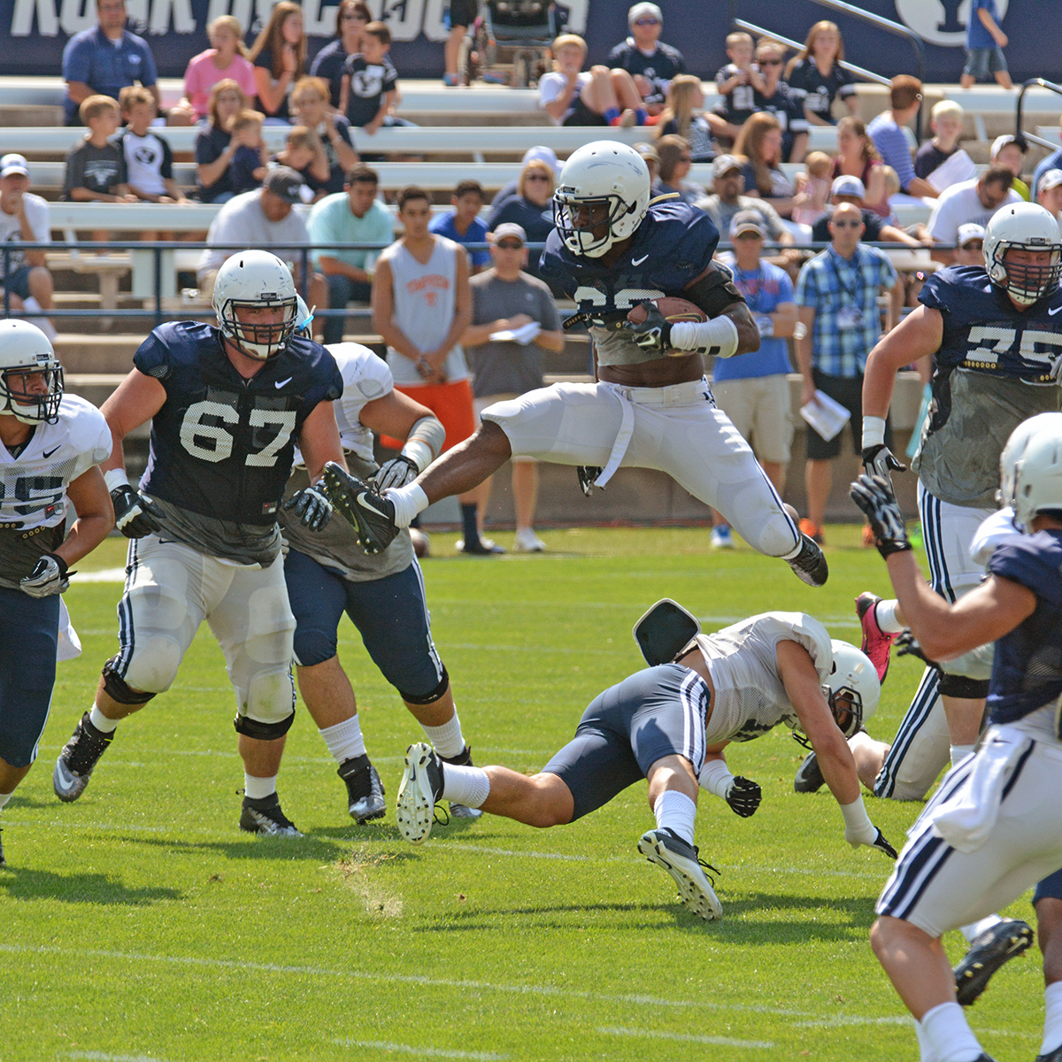 Junior running back Adam Hine gave the 5,000 BYU fans on hand Saturday a thrill when he hurdled defensive back Kai Nacua.