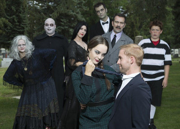 Jack Stokes is Gomez (older man with striped jacket); Shelly Stewart Truax is Morticia (long black hair and black dress); Morgan Flandro is Wednesday (green and black dress, braided pigtails; Mitch Bandley is Pugsley (younger boy with black and white striped shirt); Patrick Brannelly as Fester (bald head with black coat); David Henry as Lurch (the tall one); Brandi Washburn as Grandma (old lady); and Brandon Haden as Lucas (Wednesday's love interest - blonde hair, khaki pants).  (Photo by Mark A. Philbrick)