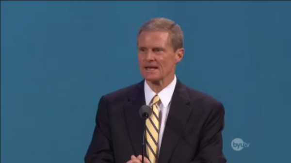 Elder Bednar speaks at a BYU Devotional in the Marriott Center. He taught Church members to use social media to share uplifting messages. (Screen shot photo.)