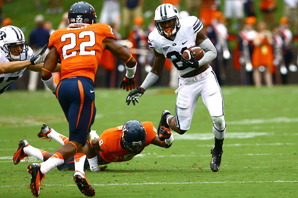 Jamaal Williams, shown here in the 2013 BYU season opener against Virginia, will miss the UConn game because of an honor code violation. (BYU Photo)