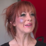 Lindsey Stirling gets her makeup done in Kid Snippets video
