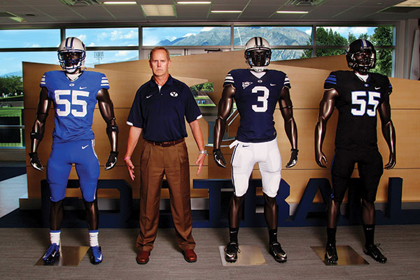 Tom Holmoe lines up with the three BYU football jerseys for 2014. (Photos by Marylyn Linge)