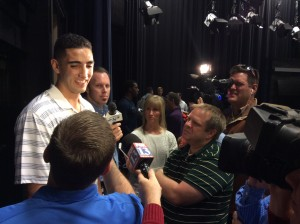 Freshman center Corbin Kaufusi speak with reporters during basketball media day on Oct. 2, 2014. (Steven Potter)