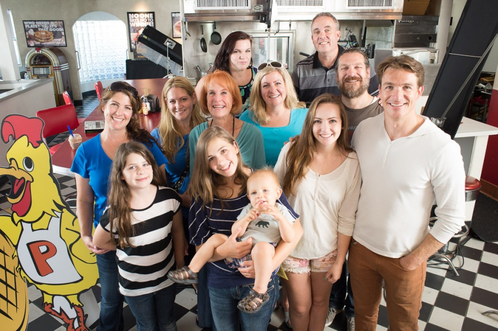 "Charlene Johnson, center, is surrounded by her family on the set of ""Waffle Street"" in August 2014. Front (from left): Brooke Roberts, Melonie Roberts holding Alec Steadman, Lauren Elison and Brad Johnson. Middle: Liz Roberts, Jeanette Steadman, Charlene Johnson, Julie Elison and Adam Johnson. Back: Becky Johnson and Dale Elison. (Photo courtesy of Jay Drowns)"