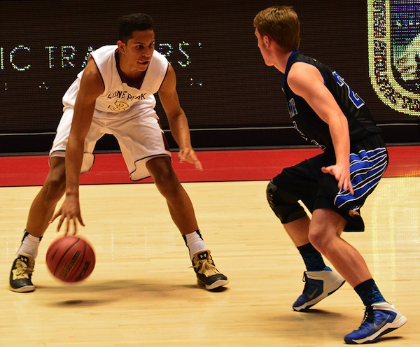 Lone Peak's Frank Jackson dribbles the ball in the 5A State Tournament last year. (Photo by Matt Bennett)