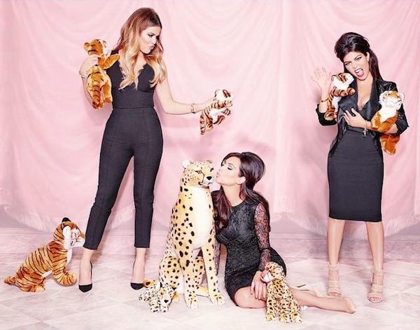 Khloe, Kim and Kourtney Kardashian pose for their Kardashian Kollection clothes line. Kim Kardashian has most recently received attention for her nude cover photos. (Photo courtesy Kim Kardashian's Facebook)