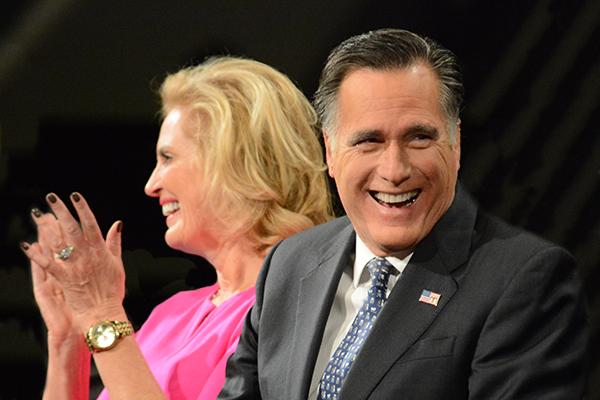 BYU alumnus Mitt Romney laughs before his BYU forum address on Tuesday morning. His wife, Ann Romney, joined him for in the Marriott Center. (Photo by Matt Bennett)