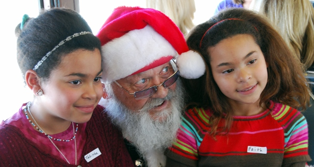 Guests visit with Santa Claus aboard the North Pole Express in this photo courtesy of the Heber Valley Railroad.