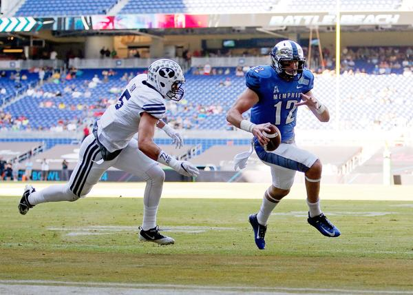 Memphis' quarterback Paxton Lynch scrambles in the Tigers' 55-48 double-overtime win over BYU in the Miami Beach Bowl on Monday, Dec. 22. (NBC Sports/Twitter)
