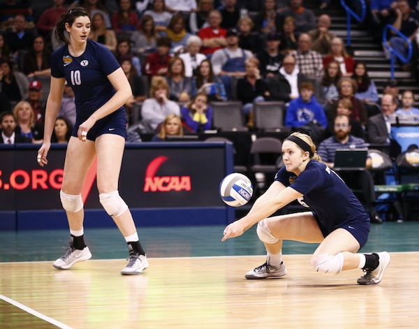 Tambre Nobles digs the ball during the NCAA Championship game against Penn State while teammate Amy Boswell looks on. The Cougars lost 3–0. (Photo by Jaren Wilkey/BYU Photo)