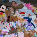 Local girls collect 1,607 stuffed animals to help at-risk children through Project Teddy Bear