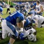 Members of BYU and Memphis participate in a scuffle following the Tigers' 55–48 win over Brigham Young in the Miami Beach Bowl on Dec. 22. (Twitter/@SunTimesMem)